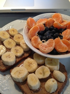 Almond Butter, Ezekiel Bread, Clementine and Blueberries
