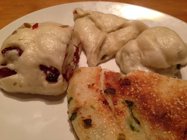 Clockwise: Cranberry Pumpkin Seed, Molten Brown Sugar, Green Scallion Roll, Pan Fried Green Onion Pancake with a Sesame crust